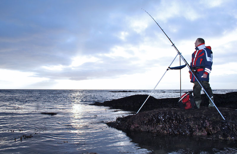 Shaun Cumming watches his rod tip for signs of winter cod