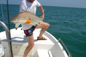 Paul Stevns with a spinner shark