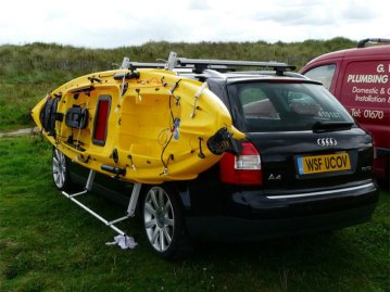 a kayak on a car carry rack