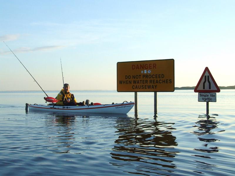kayak besie flooded road signs