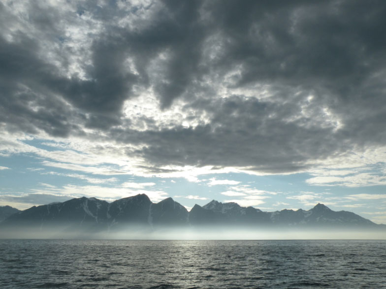 a fjord dark cloud backdrop to a charter boat trip in Norway