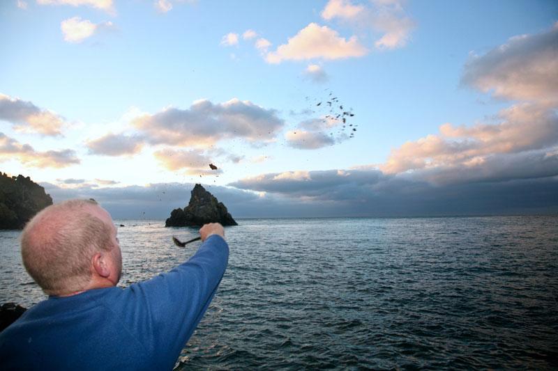 Mark Harding throwing ground bait for Alderney black bream