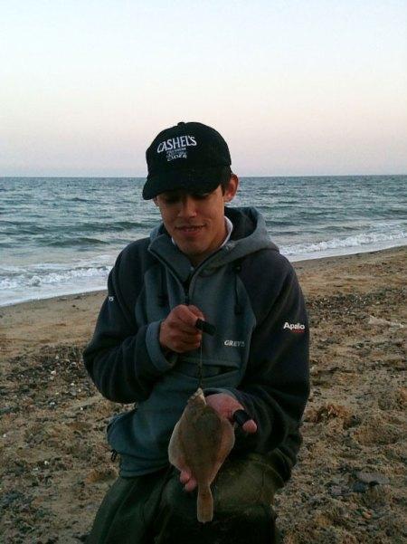 Eric Gasparro witha flounder on Kilgorman Beach