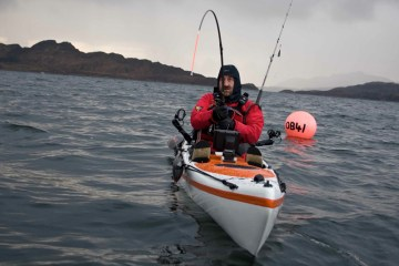 a kayak angler hooked up to a common skate