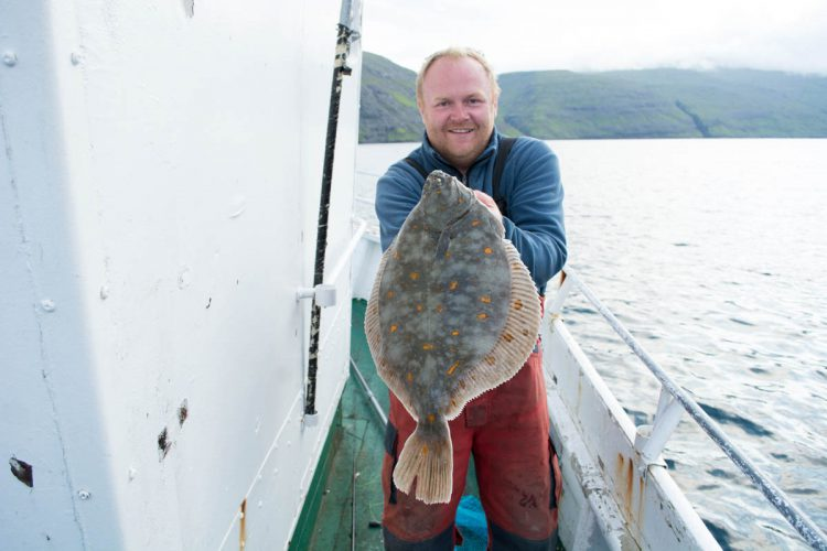 plaice fishing Faroe Islands Magni shows off a fish
