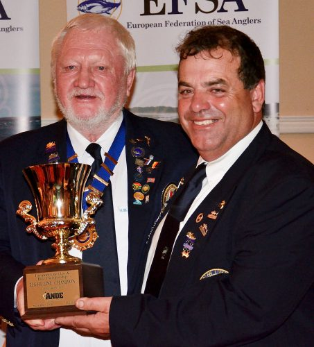 Charlie Lara receives the Ande Trophy as Light Line Champion