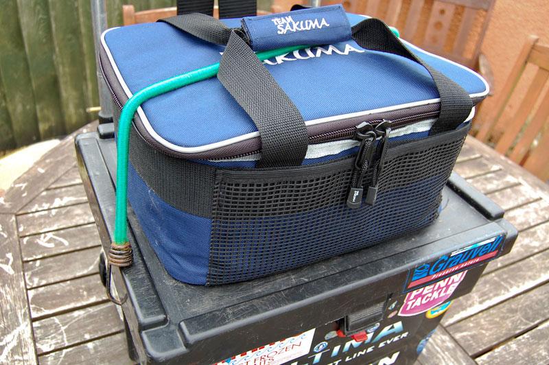 Sakuma Cooler Bag strapped to tackle box