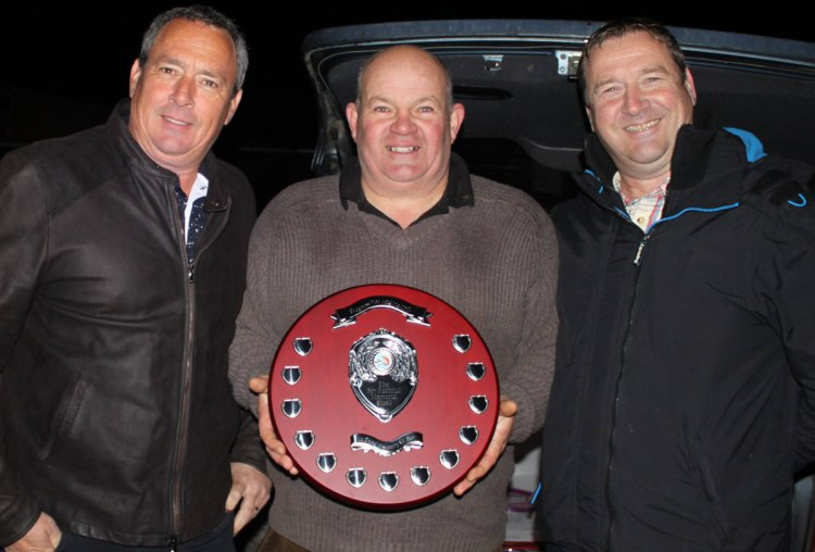 Bev's sons Jim and John Faithfull presenting their Dad's shield to Dave
