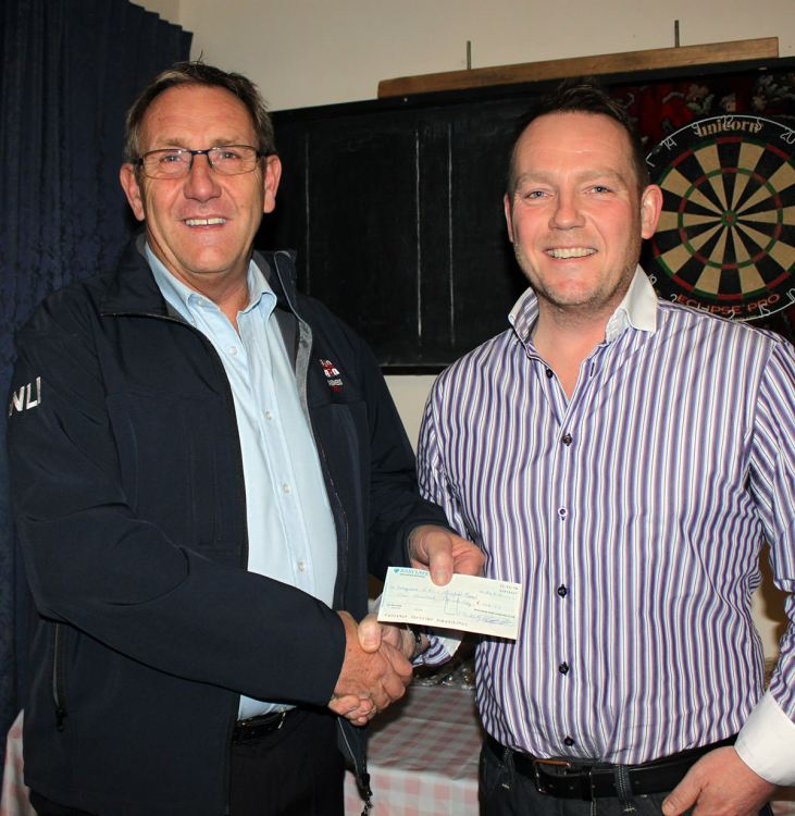 Skegness Lifeboat Coxswain Ray Chapman (left) receiving a £100 donation from SPAC Chairman Dean Sumner