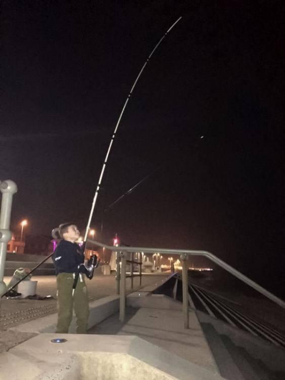 Dillan bends into a fish