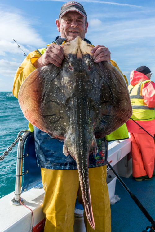 WIBAC Runner-up Derek with a 17lb undulate ray