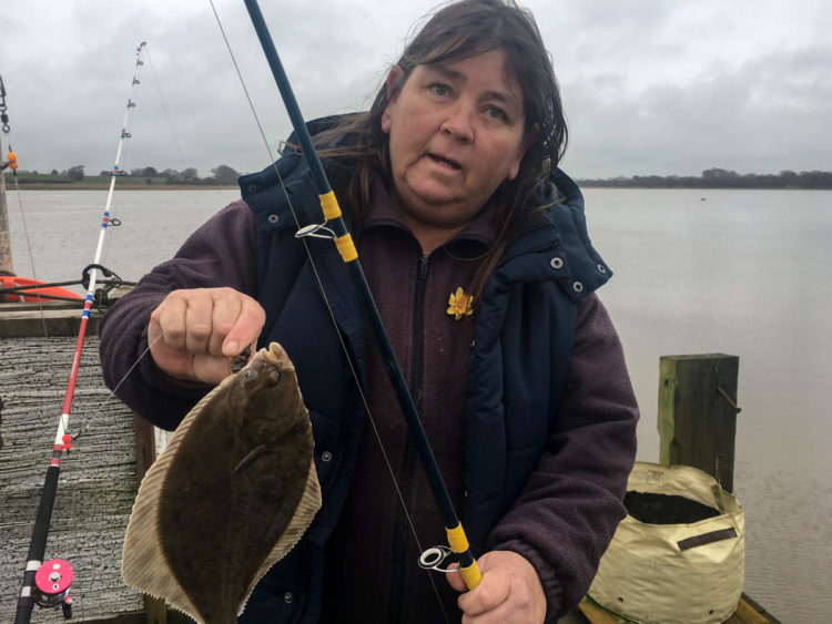 Tracey Howarth with a flounder caught from the pier