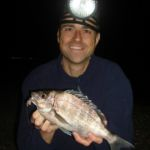 Paul Stevens with a bream at night