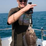 angler weiging a bream