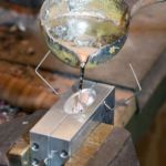 pouring molten lead into a mould