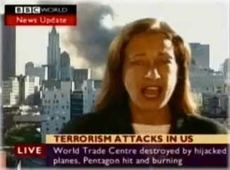 BBC World reporter Jane Stanley announces that World Trade Center 7, also known as the Salomon Brothers building, has fallen down, even though it's standing up right behind her. It's the building to the viewer's right of her head. To the left is the smoke from WTC 1 and 2. Photo: Screen shot from BBC World.