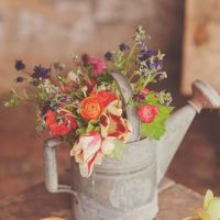 spring watering can centerpiece