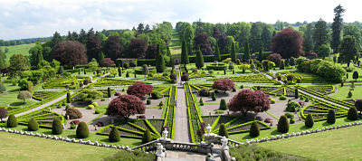 View of large garden set out in a geometrical pattern