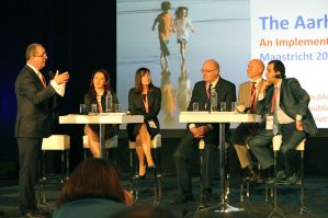 People on a panel at the Session at Maastricht Aarhus Convention in July 2014