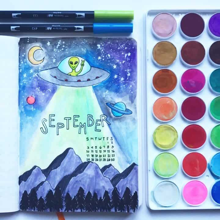 Out of this world cover page by @skulleyart If you need a truly far-out bullet journal cover page idea, this perfect space and alien theme is perfect for any month of the year!