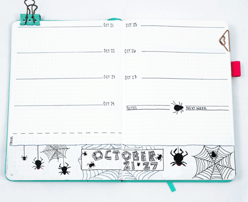 Bullet journal weekly spread with spider and spiderweb border