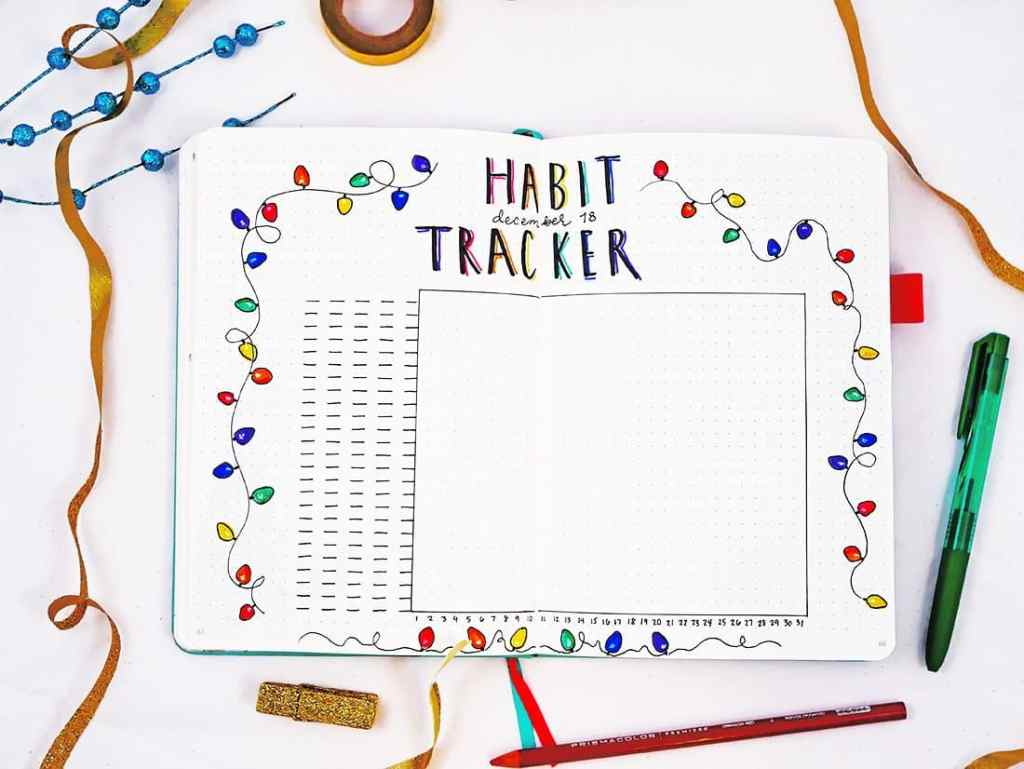 Bullet journal holiday theme habit tracker with Christmas light doodles