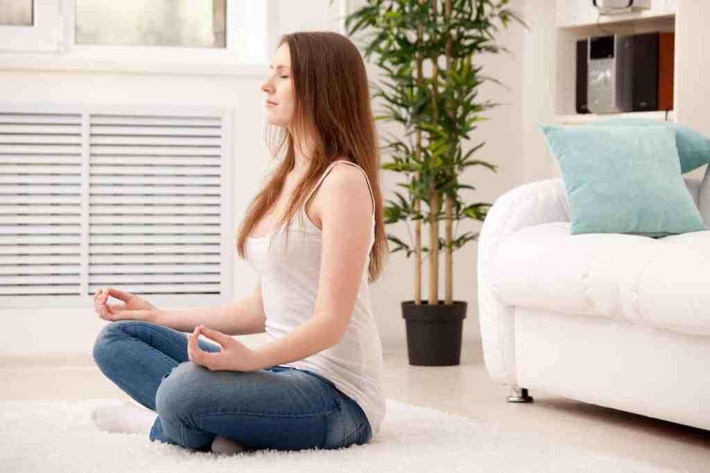 Woman meditation peacefully as part of her daily morning routine.