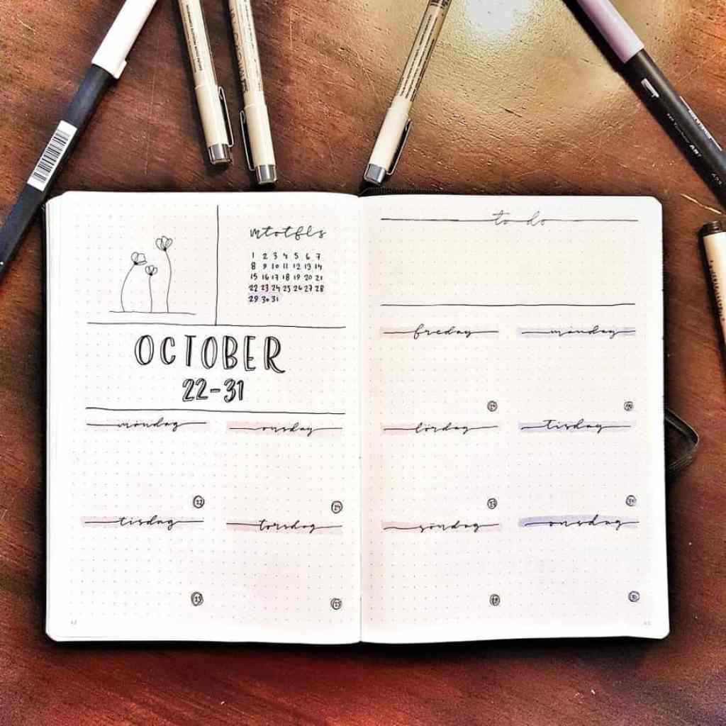 October weekly bullet journal layout on wooden background