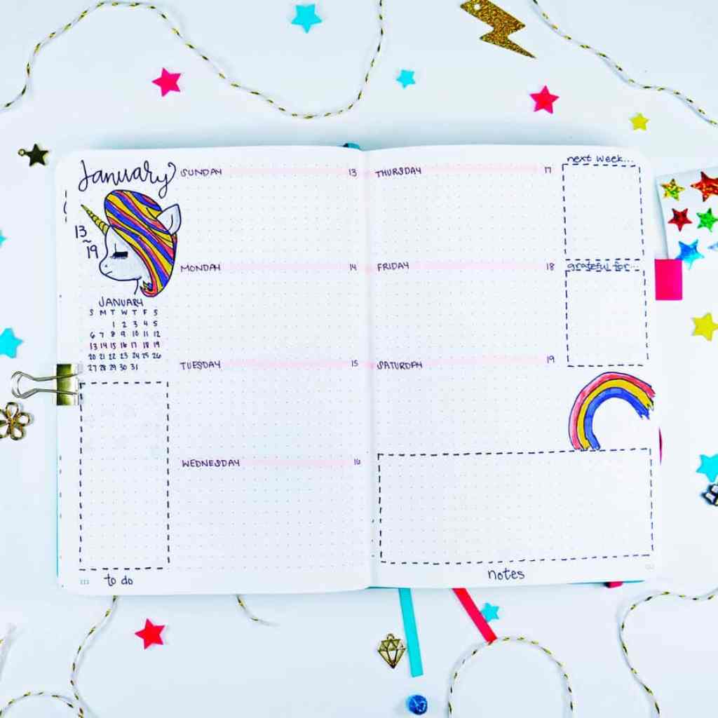 Serious unicorn bullet journal weekly layout with rainbow