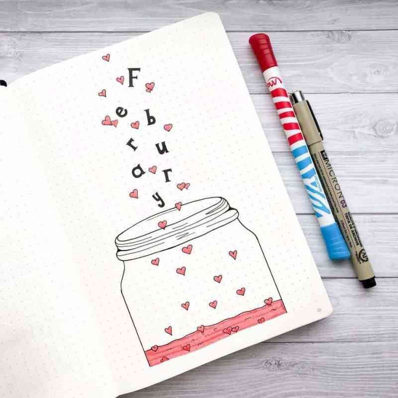 February bullet journal cover page with heart doodles in a jar
