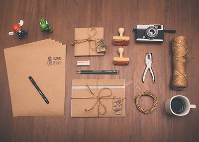 Lots of planner supplies on a wooden desk