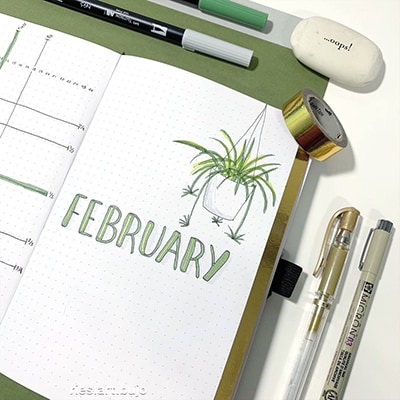 Houseplant February bullet journal cover page.