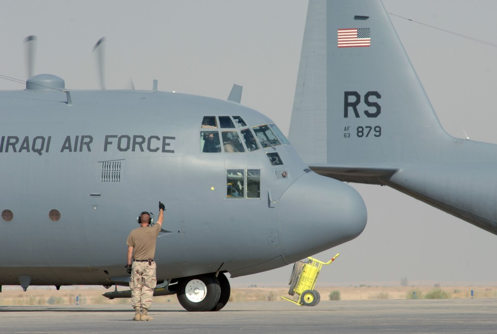 A U.S. Air Force C-130 Hercules crew chief gives the flight crew of an Iraqi Air Force C-130 Hercules a thumbs-up as they launch on a training mission from Ali Base, Iraq, on July 27, 2005.  The Hercules crew chief is attached to the 777th Expeditionary Maintenance Squadron.  DoD photo by Master Sgt. Maurice Hessel, U.S. Air Force.  (Released)