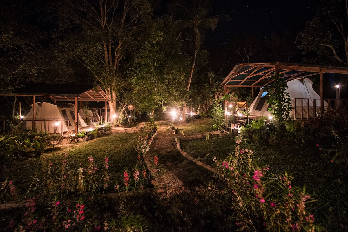 Uaxactun Camping Guatemala - Tents lit up by night