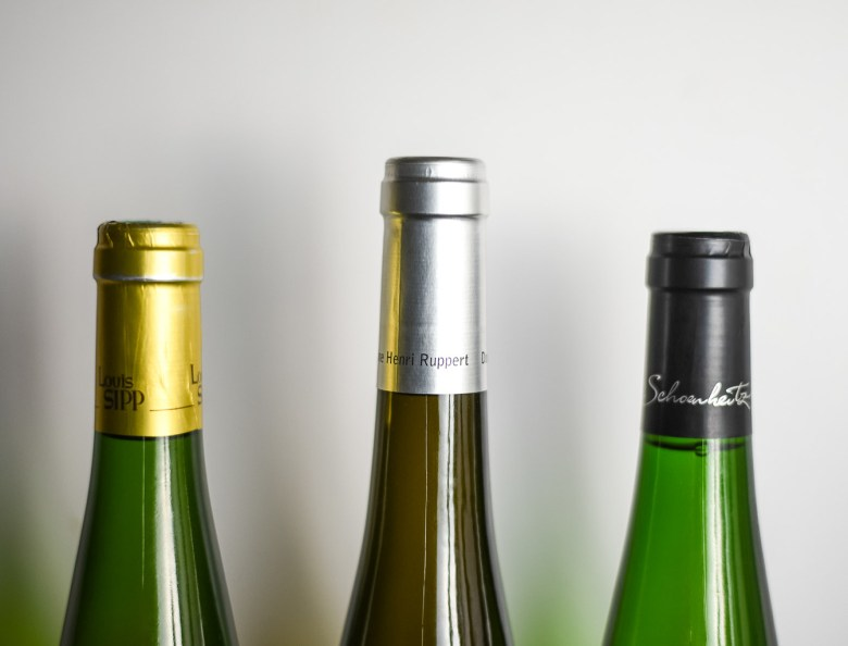 Holiday wine pairing guide for vegans and vegetarians with three bottles of white wine