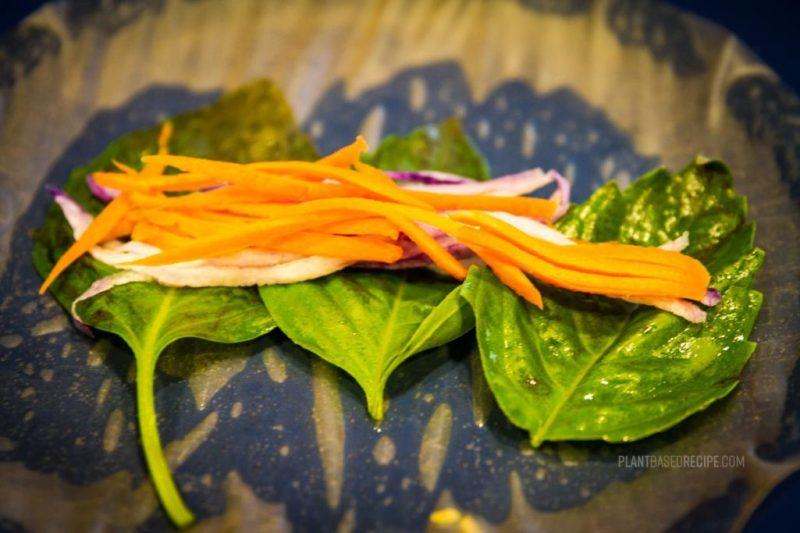 Vegetables inside a spring roll.