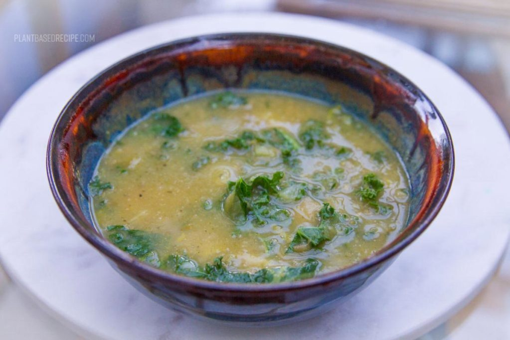 Kale, leeks and potato soup in a bowl