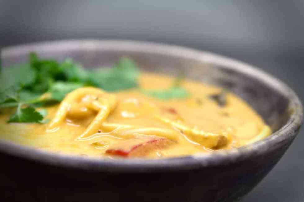 Bun bo Hue noodles in a spicy peanut soup