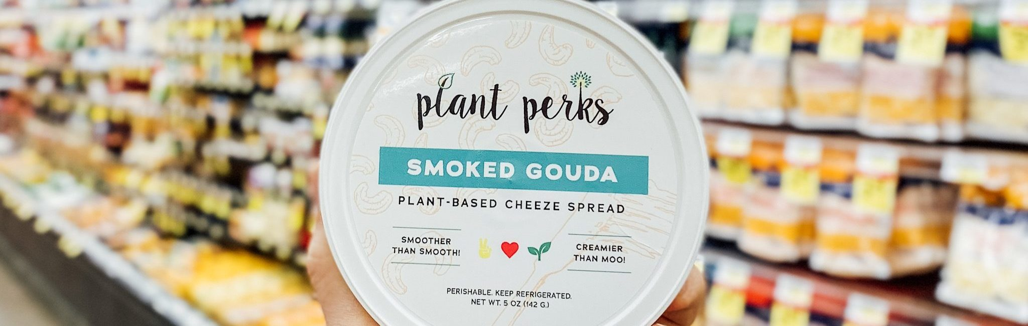 Plant Perks Smoked Gouda Vegan Cheese container in a grocery store