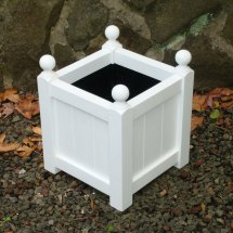 Classic-small-square-wooden-planter-with-finials-in-arctic