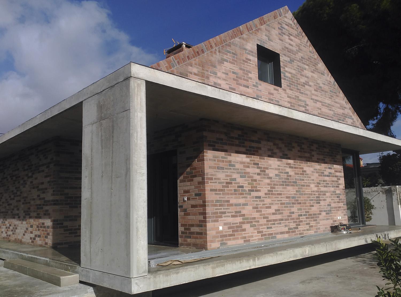 Casa revestida con plaquetas