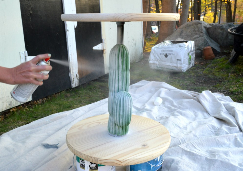 Turning a thrift store plastic cactus into a chic side table - spray painting - Plaster & Disaster