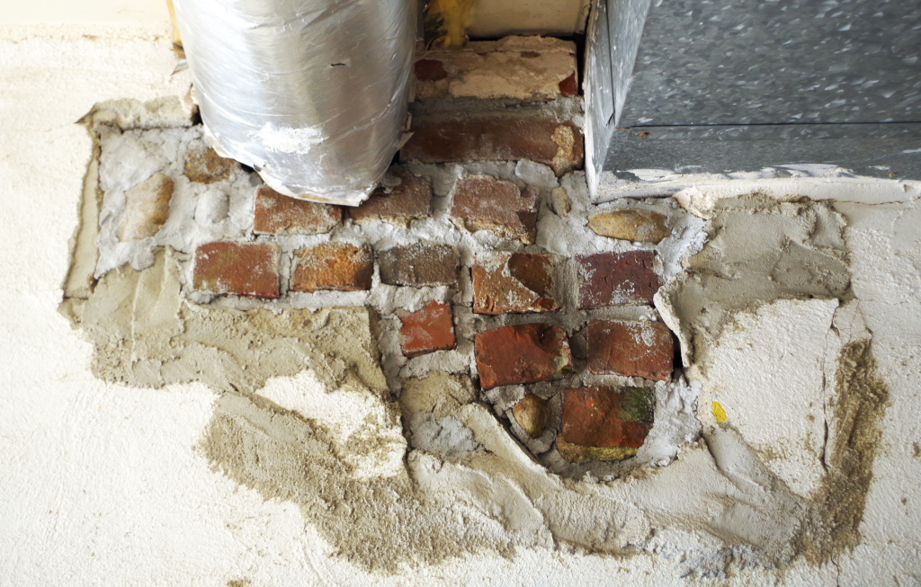 How to fix a big hole in a cement wall - Plaster & Disaster