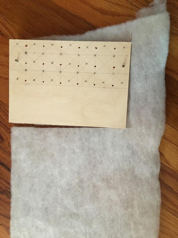 Upholstered dollhouse bed -- Plaster & Disaster