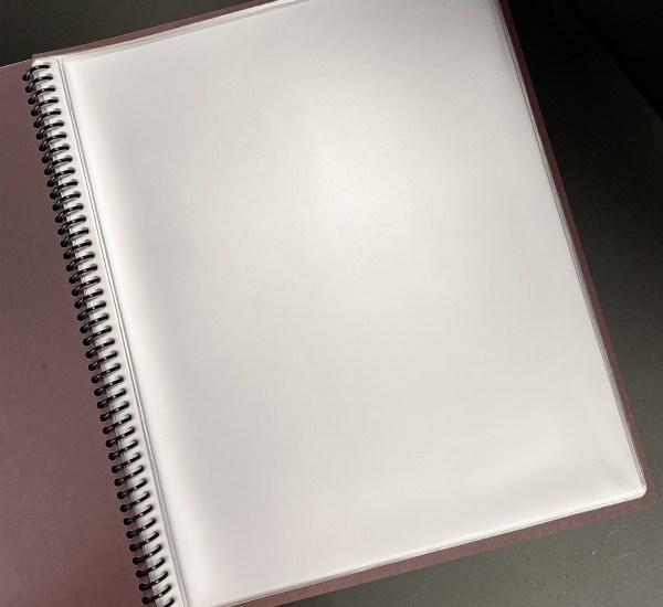Coiled bound menu sleeves