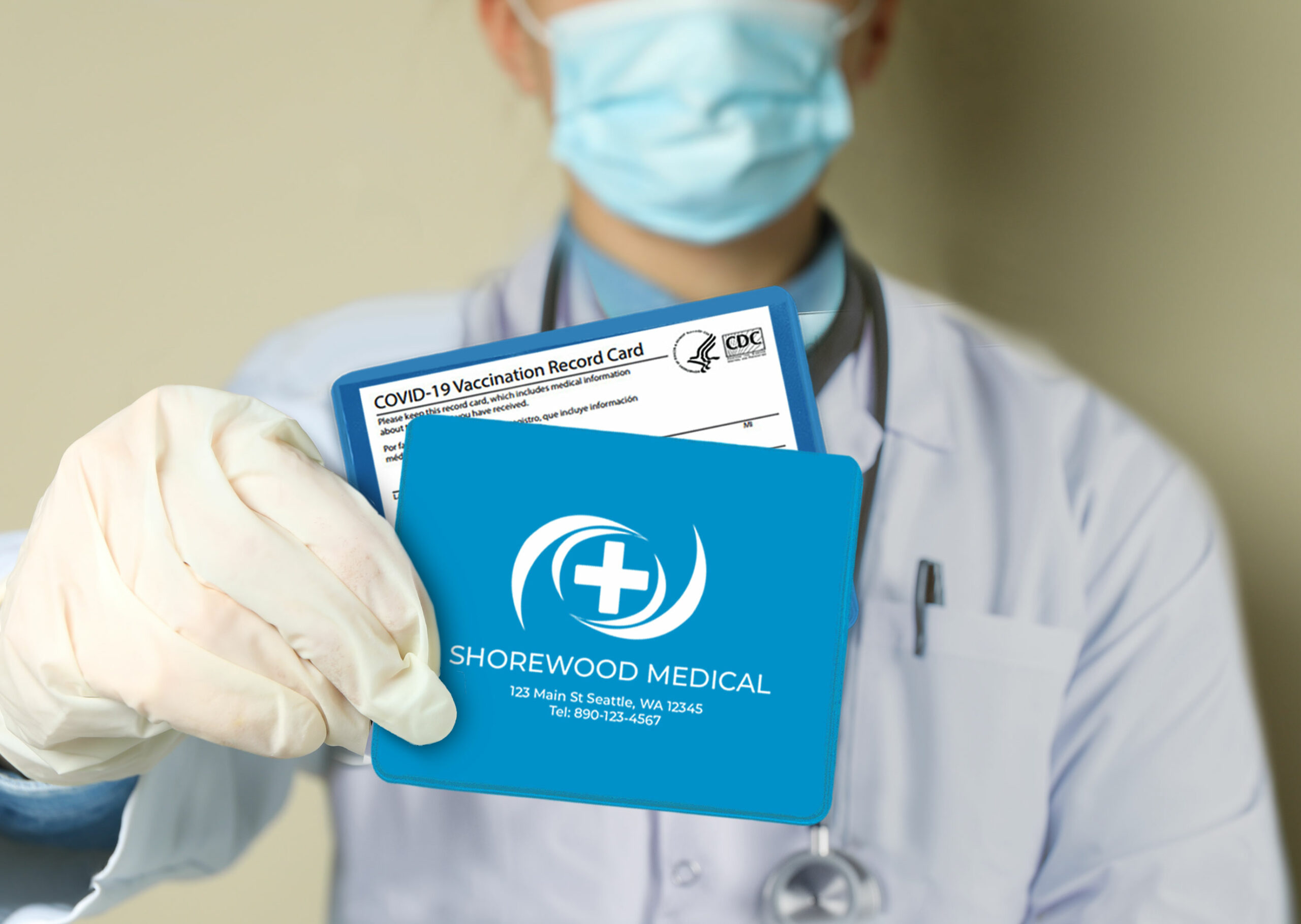 doctor holding covid vaccination card holder