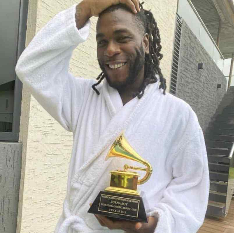 Burna Boy Praises His Parents As He Receives Grammy Plaque