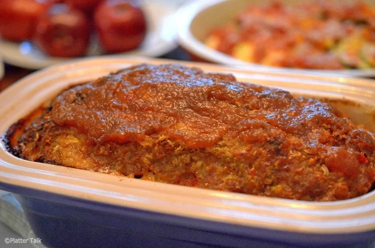 Pan of Amish meatloaf topped with apple butter.