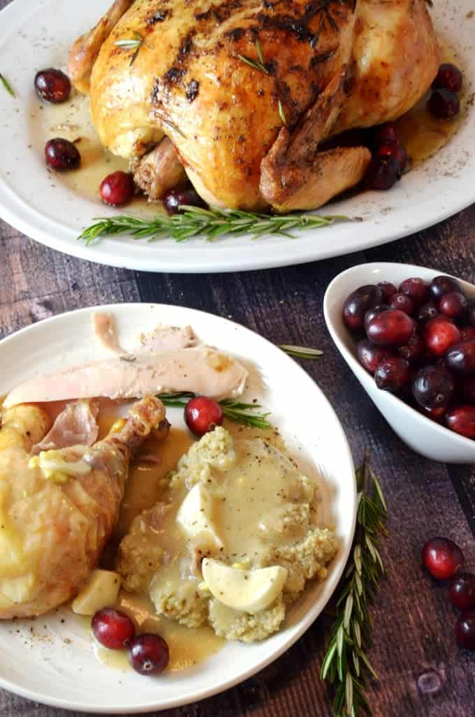 Plate of old-fashioned giblet gravy with chicken and mashed potatoes.
