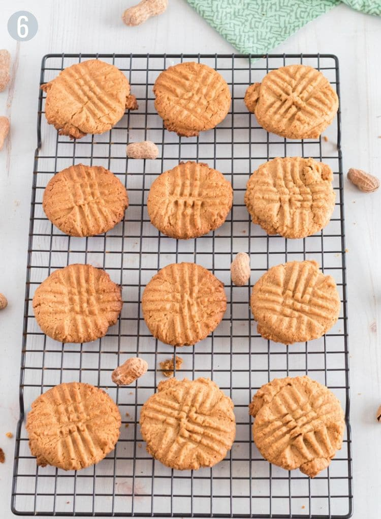 12 peanut butter cookies on a cooling rack.